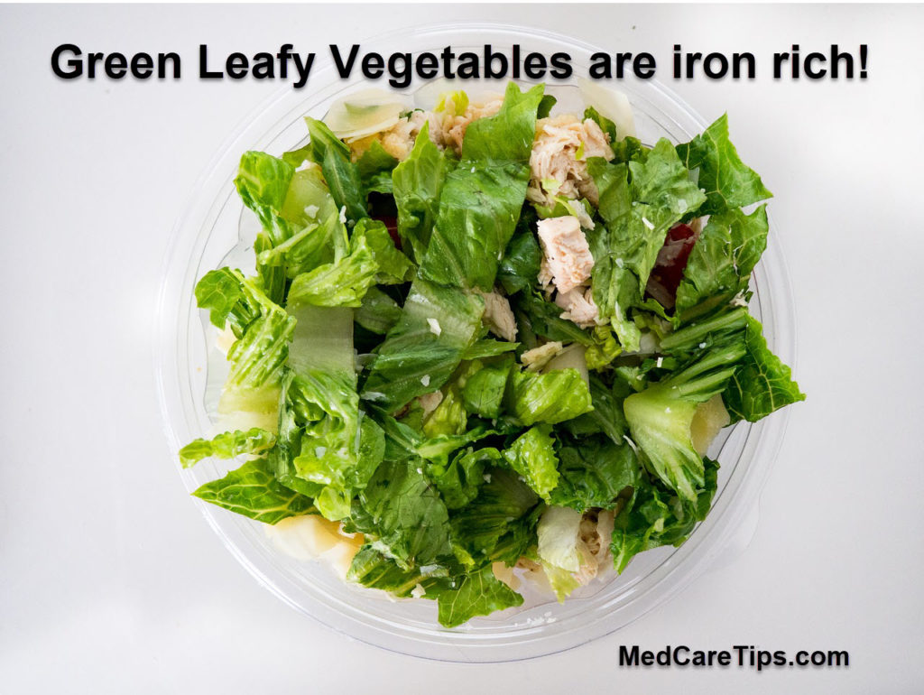 Green Leafy vegetbales in bowl. Top iron rich foods